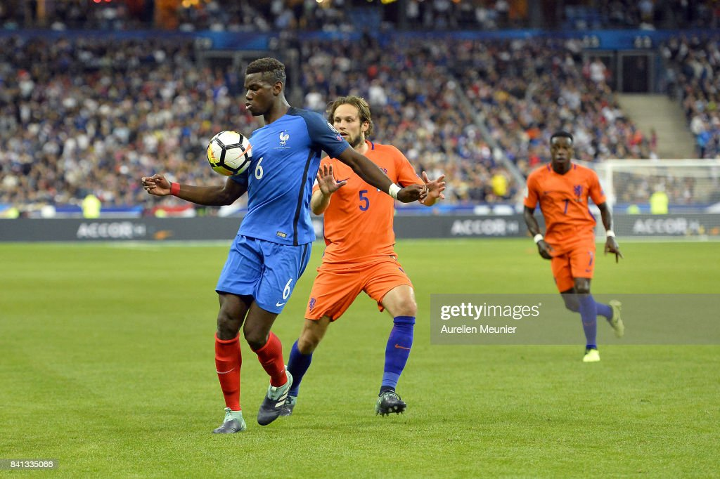 Paul Pogba of France and Daley Blind of The Netherlands fight for the ball during the FIFA 2018 World Cup Qualifier between France and The Netherlands at Stade de France on August 31, 2017 in Paris, France.