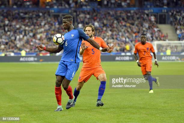 Paul Pogba of France and Daley Blind of The Netherlands fight for the ball during the FIFA 2018 World Cup Qualifier between France and The...
