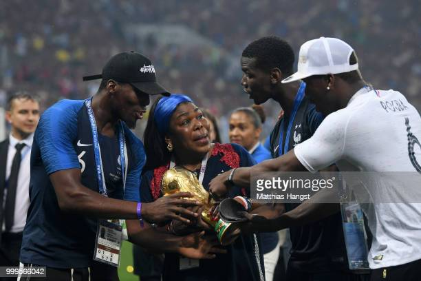 Paul Pogba of France and family brothers Florentin Pogba and Mathias Pogba and mother Yeo Pogba celebrate with the World Cup Trophy following...
