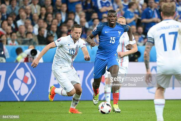 Paul Pogba of France and Gylfi Sigurdsson of Iceland during the UEFA Euro 2016 Quarter Final between France and Iceland at Stade de France on July 3...