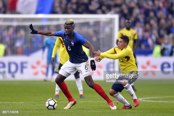 Paul Pogba of France and Juan Fernando Quintero of Colombia fight for the ball during the international friendly match between France and Colombia at...