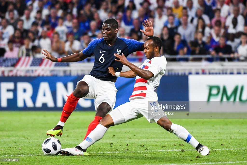 Paul Pogba of France and Julian Green of USA during the International Friendly match between France and United States at Groupama Stadium on June 9, 2018 in Lyon, France.