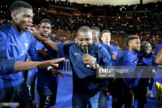 Paul Pogba of France and Magic System music group dance with the FIFA World Cup won on July 15 2018 in MoscowRussia in front of their fans after the...