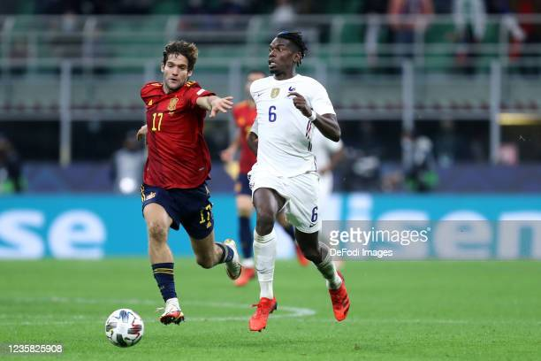Paul Pogba of France and Marcos Alonso of Spain battle for the ball during the UEFA Nations League Final match between the Spain and France at San...