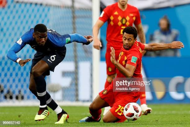 Paul Pogba of France and Mousa Dembele vie for the ball during the 2018 FIFA World Cup Russia semi final match between France and Belgium at the...