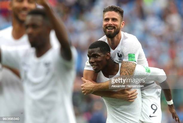 Paul Pogba of France and Olivier Giroud of France celebrate following their sides victory in the 2018 FIFA World Cup Russia Quarter Final match...