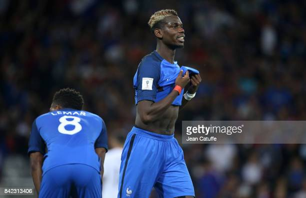 Paul Pogba of France and Thomas Lemar react after the tie following the FIFA 2018 World Cup Qualifier between France and Luxembourg at the Stadium on...