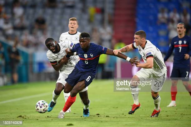 Paul Pogba of France battles for possession with Antonio Ruediger and Robin Gosens of Germany during the UEFA Euro 2020 Championship Group F match...