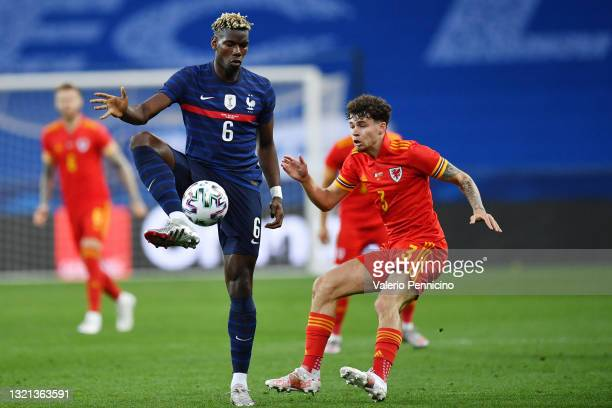 Paul Pogba of France battles for possession with Neco Williams of Wales during the international friendly match between France and Wales at Allianz...