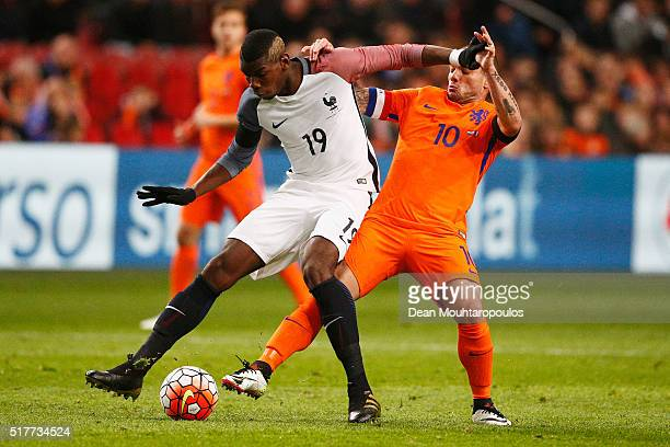 Paul Pogba of France battles for the ball with Wesley Sneijder of the Netherlands during the International Friendly match between Netherlands and...
