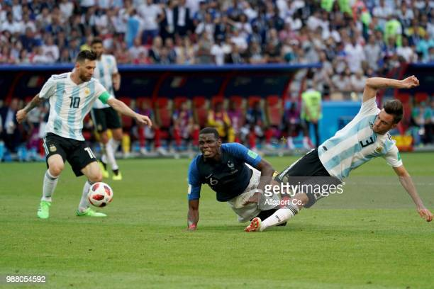 Paul Pogba of France battles with Nicolas Tagliafico of Argentina during the 2018 FIFA World Cup Russia Round of 16 match between France and...