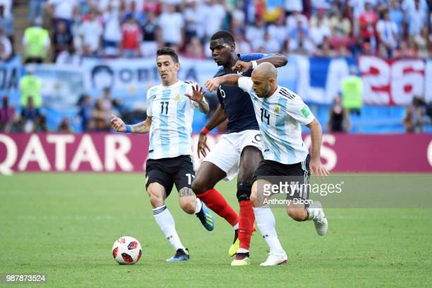 Paul Pogba of France between Angel di Maria and Javier Mascherano of Argentina during the FIFA World Cup Round of 16 match between France and...