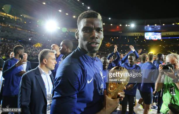 Paul Pogba of France celebrate the FIFA World Cup with fan after the UEFA Nations League A group one match between France and Netherlands at Stade de...