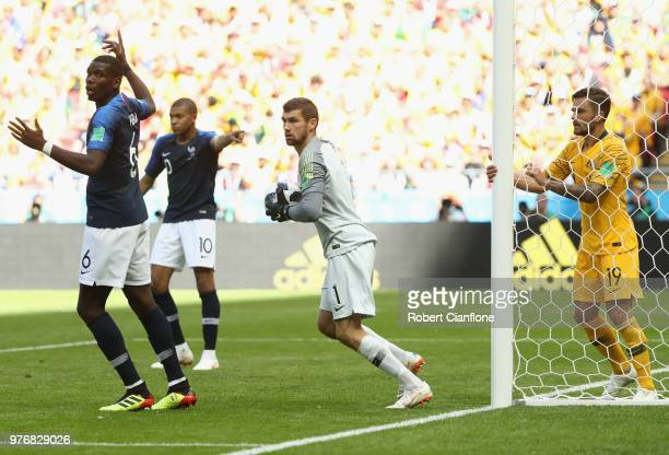 Paul Pogba of France celebrates after scoring his side's second goal as Socceroos goalkeeper Mathew Ryan looks on during the 2018 FIFA World Cup...