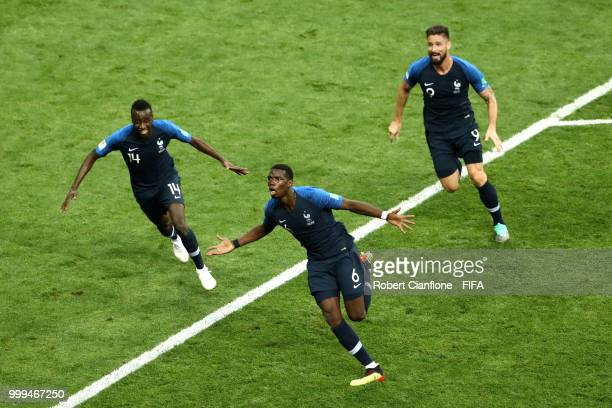 Paul Pogba of France celebrates after scoring his side's third goal, with team mates Blaise Matuidi and Olivier Giroud during the 2018 FIFA World Cup...