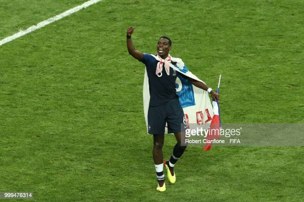 Paul Pogba of France celebrates his team's victory, holding the French flag, following the 2018 FIFA World Cup Final between France and Croatia at...