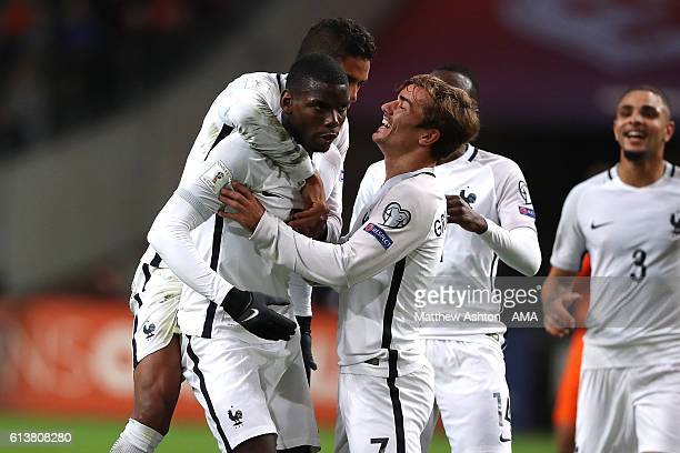 Paul Pogba of France celebrates scoring his team's first goal to make the score 01 with his teammates during the FIFA 2018 World Cup Qualifier...