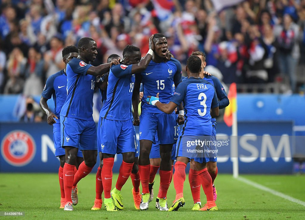Paul Pogba (3rd R) of France celebrates scoring his team's second goal with his team mates during the UEFA EURO 2016 quarter final match between France and Iceland at Stade de France on July 3, 2016 in Paris, France.