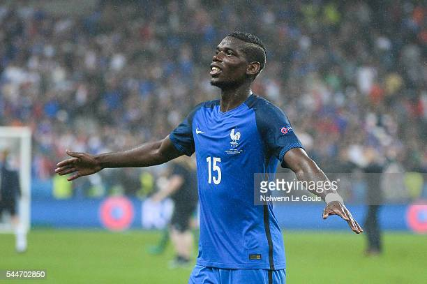 Paul Pogba of France celebrates victory during the UEFA Euro 2016 Quarter Final between France and Iceland at Stade de France on July 3 2016 in Paris...