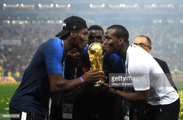 Paul Pogba of France celebrates victory with brothers Mathias and Florentin during the 2018 FIFA World Cup Final between France and Croatia at...
