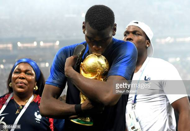 Paul Pogba of France celebrates victory with mother Yeo and brother Mathias during the 2018 FIFA World Cup Final between France and Croatia at...