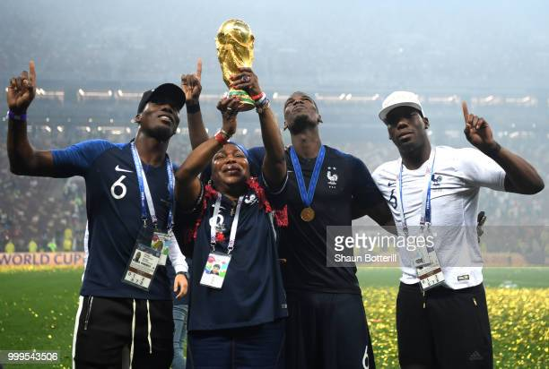 Paul Pogba of France celebrates victory with mother Yeo and brothers Mathias and Florentin during the 2018 FIFA World Cup Final between France and...