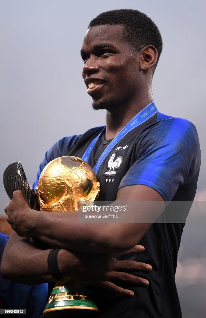 Paul Pogba of France celebrates victory with the World Cup trophy following the 2018 FIFA World Cup Final between France and Croatia at Luzhniki Stadium on July 15, 2018 in Moscow, Russia.