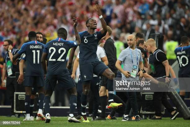 Paul Pogba of France celebrates winning the World Cup with teammate Benjamin Mendy of France during the 2018 FIFA World Cup Russia Final between...