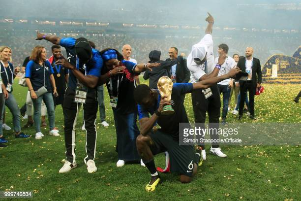Paul Pogba of France celebrates with his mother Yeo and brothers Mathias and Florentin as they perform a dab with the trophy after the 2018 FIFA...