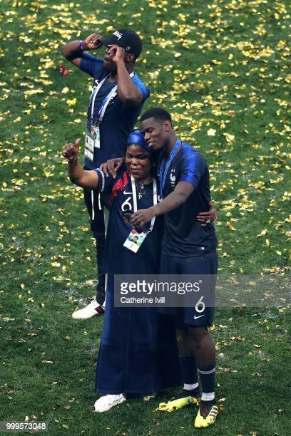 Paul Pogba of France celebrates with his mother Yeo Pogba following his sides victory in the 2018 FIFA World Cup Final between France and Croatia at...