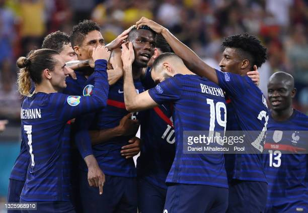 Paul Pogba of France celebrates with team mates after scoring their side's third goal during the UEFA Euro 2020 Championship Round of 16 match...