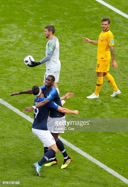 Paul Pogba of France celebrates with teammate Olivier Giroud after scoring his team's second goal as Mathew Ryan of Australia lookds dejected during...