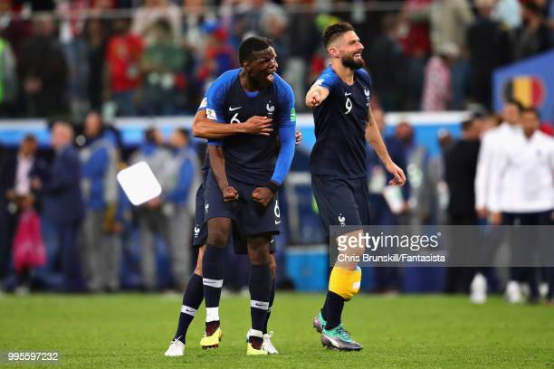 Paul Pogba of France celebrates with teammates Olivier Giroud and Raphael Varane after the 2018 FIFA World Cup Russia Semi Final match between...
