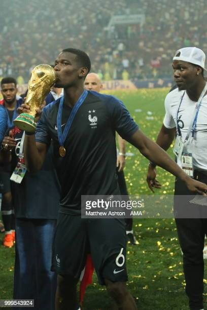 Paul Pogba of France celebrates with the FIFA World Cup trophy with family members during the 2018 FIFA World Cup Russia Final between France and...