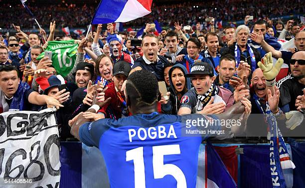 Paul Pogba of France celebrates with the supporters after his team's 52 win in the UEFA EURO 2016 quarter final match between France and Iceland at...