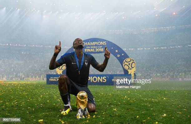 Paul Pogba of France celebrates with the World Cup Trophy following his sides victory in the 2018 FIFA World Cup Final between France and Croatia at...