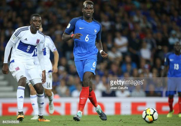 Paul Pogba of France Christopher Martins Pereira of Luxembourg during the FIFA 2018 World Cup Qualifier between France and Luxembourg at the Stadium...