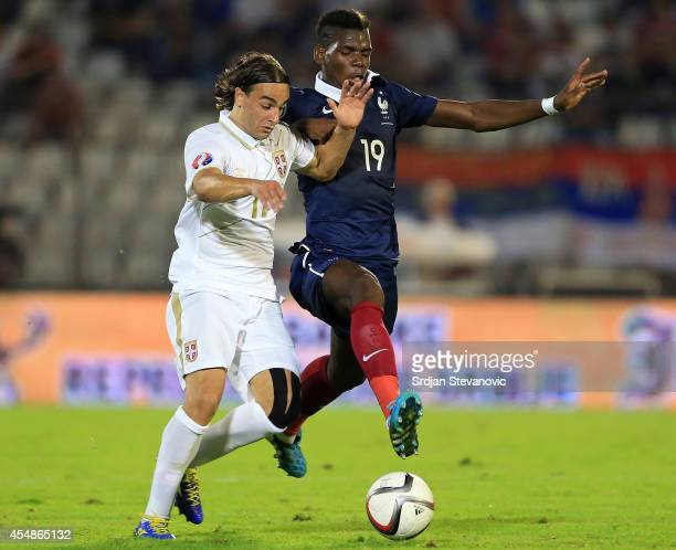 Paul Pogba of France competes for the ball with Lazar Markovic of Serbia during the International friendly match between Serbia and France at the...