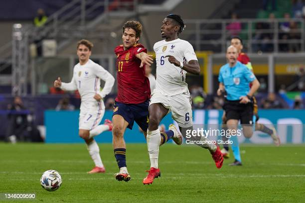 Paul Pogba of France competes for the ball with Marcos Alonso of Spain during the UEFA Nations League 2021 Final match between Spain and France at...