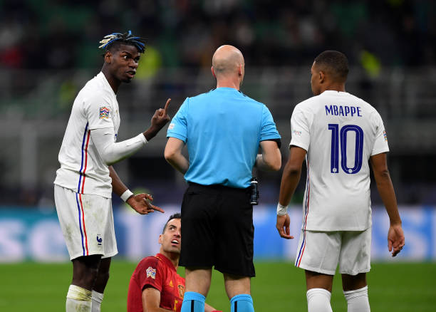 Paul Pogba of France complains to match referee, Anthony Taylor after being shown a yellow card during the UEFA Nations League 2021 Final match...
