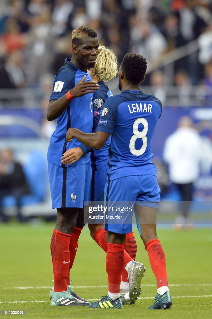 Paul Pogba of France congratulates teammate Thomas Lemar after he scored during the FIFA 2018 World Cup Qualifier between France and The Netherlands at Stade de France on August 31, 2017 in Paris, France.