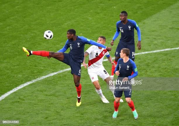 Paul Pogba of France controls the ball under pressure from Paolo Guerrero of Peru during the 2018 FIFA World Cup Russia group C match between France...