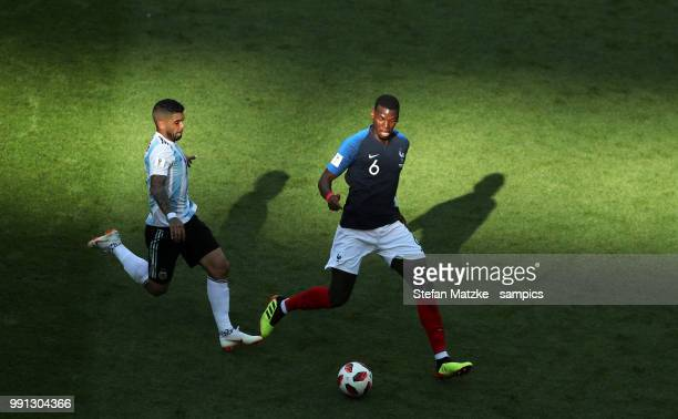 Paul Pogba of France Ever BANEGA of Argentina during the 2018 FIFA World Cup Russia Round of 16 match between France and Argentina at Kazan Arena on...