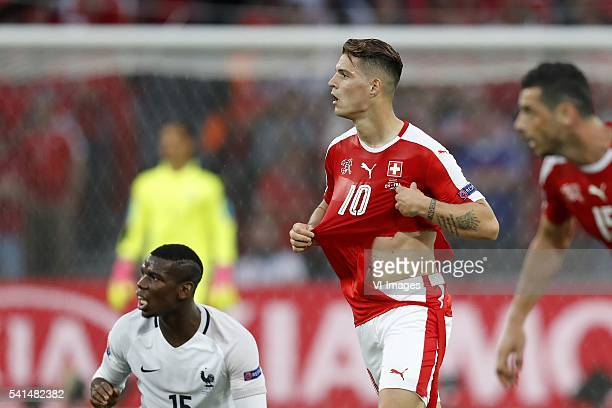 Paul Pogba of France Granit Xhaka of Switzerland with broken shirt of Puma during the UEFA EURO 2016 Group A group stage match between Switzerland...