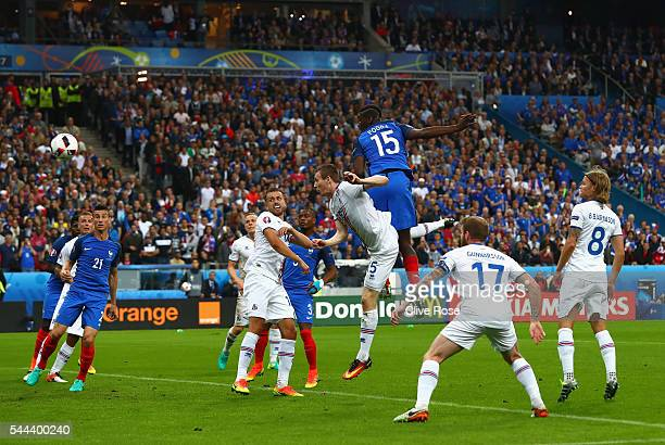 Paul Pogba of France heads the ball to score his team's second goal during the UEFA EURO 2016 quarter final match between France and Iceland at Stade...