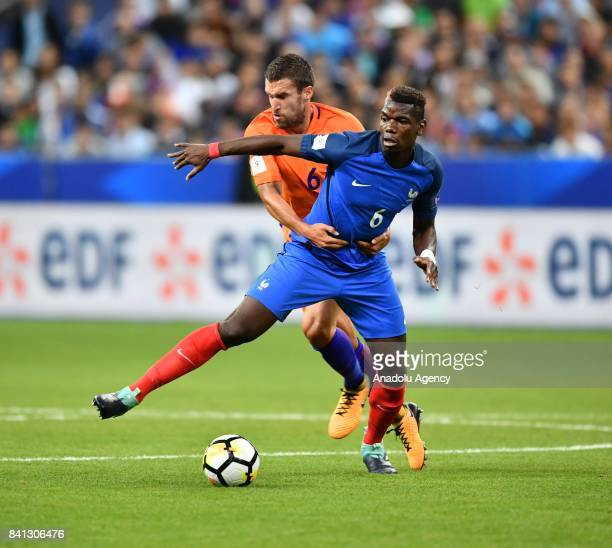 Paul Pogba of France in action against Kevin Strootman of Netherlands during the FIFA World Cup 2018 qualifying Group A match between France and...