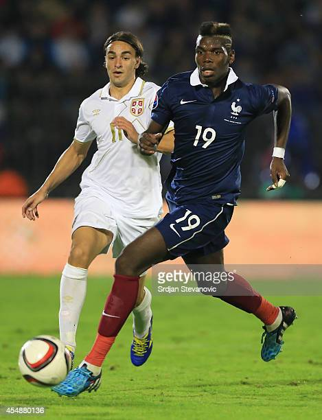 Paul Pogba of France in action against Lazar Markovic of Serbia of Serbia during the International friendly match between Serbia and France at the...