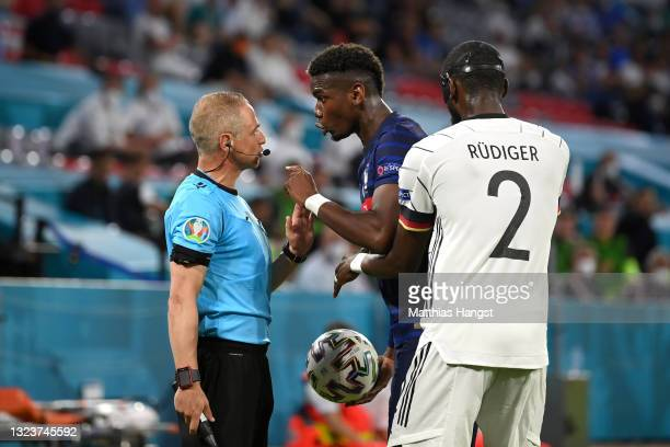 Paul Pogba of France interacts with Assistant Referee, Juan Carlos Yuste after a challenge with Antonio Ruediger of Germany during the UEFA Euro 2020...