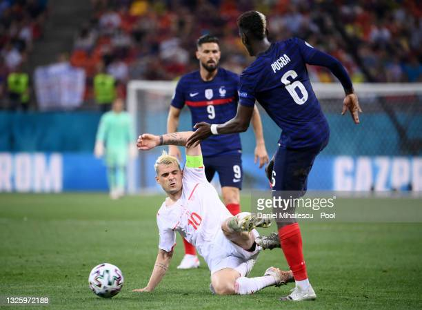 Paul Pogba of France is challenged by Granit Xhaka of Switzerland during the UEFA Euro 2020 Championship Round of 16 match between France and...