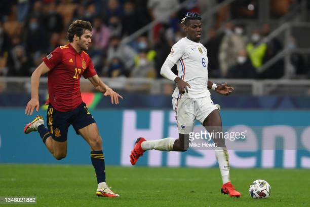 Paul Pogba of France is challenged by Marcos Alonso of Spain during the UEFA Nations League 2021 Final match between Spain and France at San Siro...